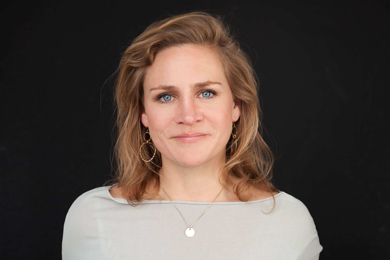 Portretfoto van Aline Staal, coahc bij QiQ Amsterdam